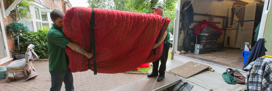 sofa wrapped up carrying harveys